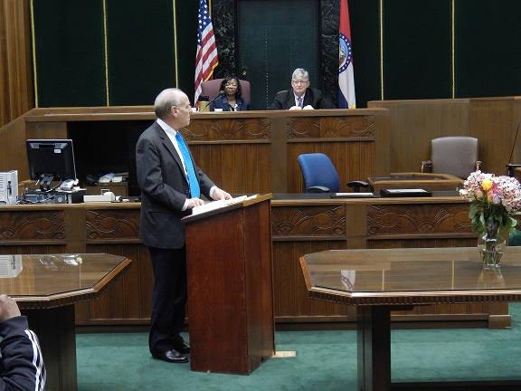 Retired Judge James R. Dowd addresses the 100th graduation ceremony of the St. Louis Drug Court. In the background are Drug Court Commissioners Rochelle Woodiest and James Sullivan.